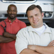 Two Men In An Auto Shop - Stock Photo