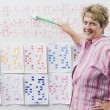 Elementary Teacher Teaching Arithmetic — Stock Photo