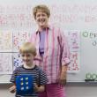 Teacher And Little Boy In Front Of Class — Stock Photo #21829799