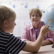 Stock Photo: Little Boy Learning Geography