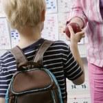 Little Boy Handing Teacher An Apple — Stock Photo #21829877