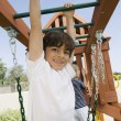 Little Boy On A Jungle Gym - Stock Photo