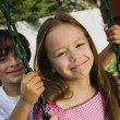 Little Boy Swinging Girl — Stock Photo