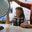 Stock Photo: Little Girl Learning Geography