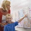 Little Boy Pointing To A Calendar Date For Teacher — Stock Photo