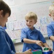 Boys Playing With Toys In Playschool - Stock Photo
