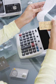 Woman Adding up Credit Card Charges — Stock Photo