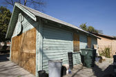 Boarded Up Garage of Empty House — Stock Photo