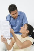Couple Looking At Bills — Stock Photo