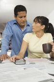 Couple Calculating Finance At Home — Stock Photo