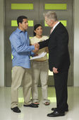 Worried Couple Shaking Hands With Advisor — Stok fotoğraf
