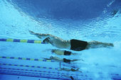 Male Swimmers Racing In Pool — ストック写真