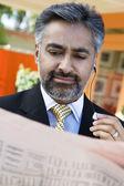 Businessman Reading Newspaper — Stock Photo