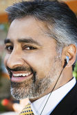 Businessman Listening Music Through Earphone — Stock Photo