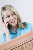 Woman With Newspaper On Call — Stock Photo