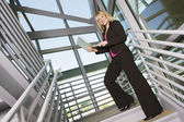 Businesswoman Using Laptop On Staircase — Stock Photo