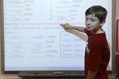 Boy Pointing On White Board — Stock Photo