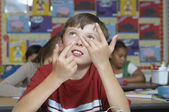 Boy Using Fingers To Count In Classroom — Stock Photo