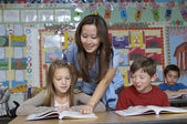 Teacher Assisting Students — Stock Photo