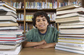 Boy Sitting At Desk With Books — Stock Photo