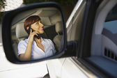 Reflection Of Businesswoman On Call — Stock Photo
