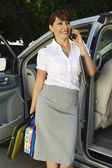 Businesswoman On Call While Standing By Car — Stockfoto