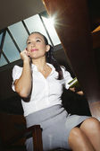 Businesswoman On Call While Sitting On Chair — Стоковое фото