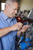 Mechanic Repairing Motorcycle Engine — Stock Photo