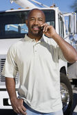 Truck Driver On Phone In Front Of A Truck — Stock Photo