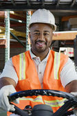 Confident Industrial Worker Driving Forklift At Workplace — Stock Photo