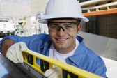 Workman Using a Spirit Level — Stock Photo