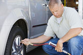 Mechanic Inflating RVs Tire — Stock Photo