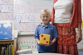 Teacher With Little Boy Holding Large Dice — Stock Photo