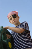 Boy Dressed As Pirate Holding A Steering Wheel — Stock Photo