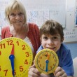 Stock Photo: Little Boy Learning To Tell Time