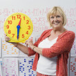Stock Photo: Teacher Showing Class Clock