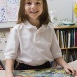 Little Girl With A Picture Puzzle - Stock Photo