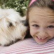 Little Girl With Her Pet Dog - Stock Photo