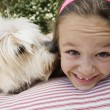 Little Girl With Her Pet Dog - Stok fotoraf