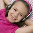 Little Girl Listening To Music - Stock Photo