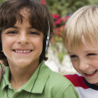 Boy Listening Music With Friend — Stock Photo