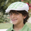 Happy Boy In Flat Hat - Stock Photo