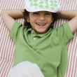 Boy Wearing Newsboy Cap - Stock Photo