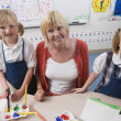 Teacher With Students In Art Class — Foto Stock