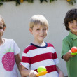 Kids Holding Eggs In Spoons For Egg Race — Stock Photo #21831237
