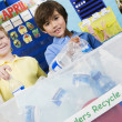 Stock Photo: Elementary Students With Recycling Container