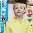 Foto Stock: Boy Getting Height Measured By Teacher