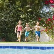 Kids Running Toward Swimming Pool — Stock Photo