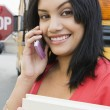 Student Using Cell Phone By School Bus — Stock Photo