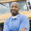 Teacher In Front Of School Bus - Stockfoto